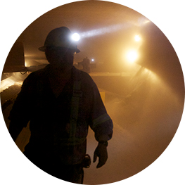 mine workers with headlamps